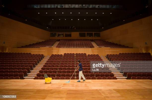 cleaning up a theather - janitor stock photos and pictures