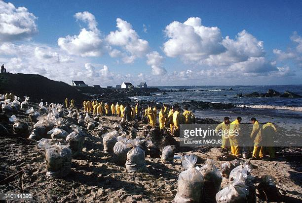 Cleaning up beaches due to the sinking of the Amoco Cadiz in Portsall France in March 1978