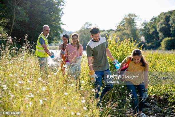 cleaning up the environment - group of people stock pictures, royalty-free photos & images