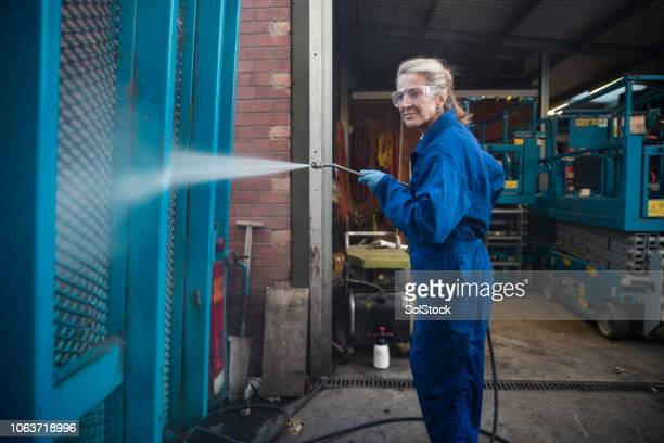 cleaning vehicle with high-pressure water hose - high pressure cleaning stock pictures, royalty-free photos & images