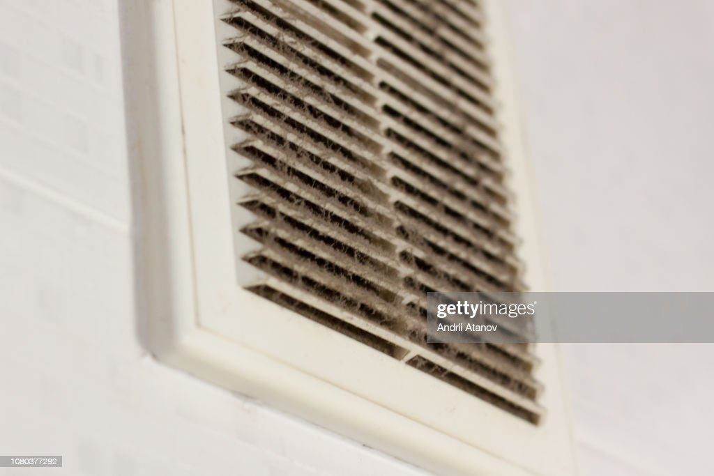 cleaning ventilation plastic dust. the filter is completely clogged with dust and dirt. dirty ventilation in the room. Disinfection service. : Stock Photo