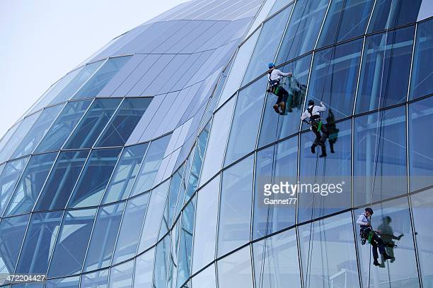 cleaning windows at the sage gateshead - window cleaning stock photos and pictures