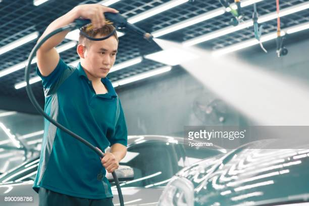cleaning with high pressure equipment - car wash stock photos and pictures