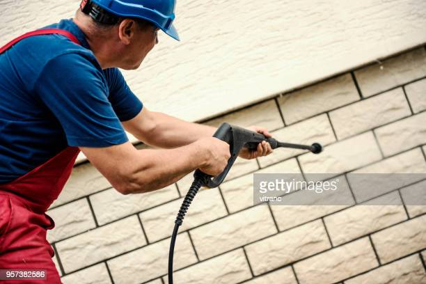 cleaning with high pressure - high pressure cleaning stock pictures, royalty-free photos & images