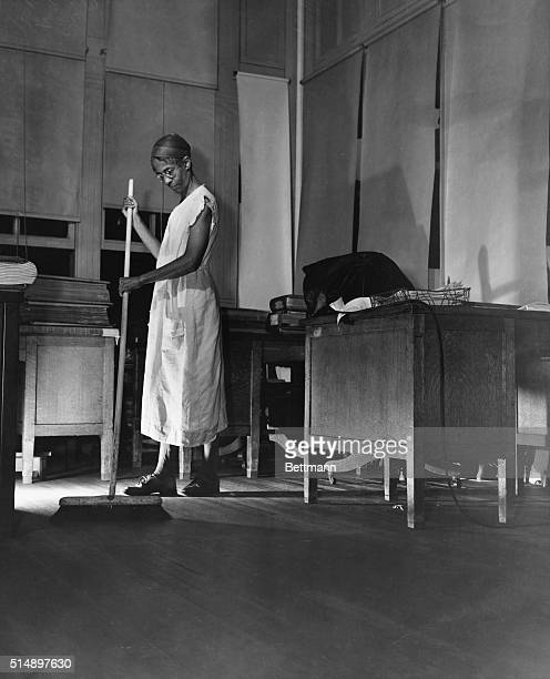 Cleaning woman Ella Watson brooming up a government office Photo by Gordon Parks