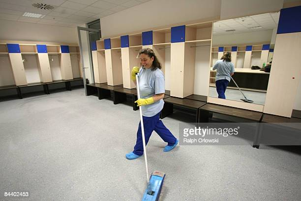 A cleaning woman wipes the floor of a team dressing room at the RheinNeckarArena of Bundesliga team 1899 Hoffenheim on January 22 2009 in Sinsheim...