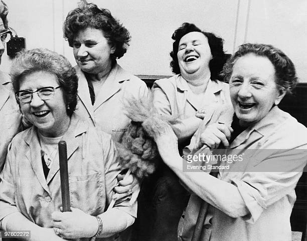 Cleaning women celebrate equal pay day at Kensington Town Hall in London January 1975 From left to right Mrs Florrie Cole Mrs Lily Davis Mrs Ann...