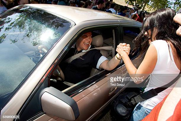 Cleaning women leaving the Neverland estate shake hands with pop singer Michael Jackson's fans as they celebrate his Not Guilty verdict today The...