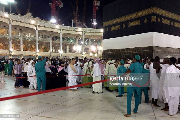 Cleaning workers do the internal cleaning of the Kaaba where the Muslims visit for Hajj and Umrah as the prospective pilgrims continue their prayers...