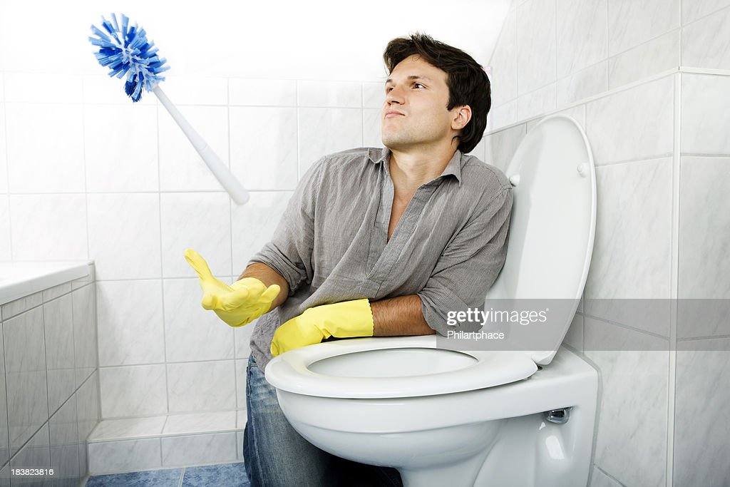 Cleaning Young Man In Bathroom Stock Photo