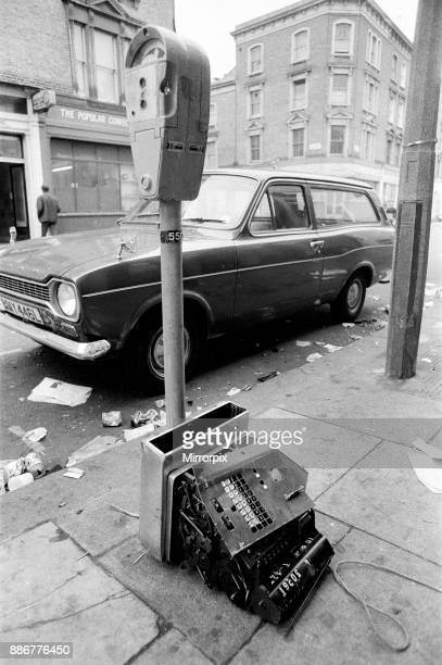 Cleaningup began in the streets of Notting Hill after monday nights rioting following the Carnival smashed cash register from the CoOp store 31st...
