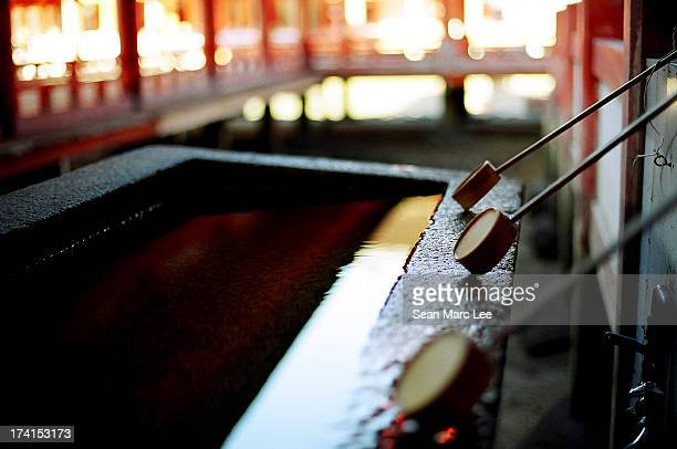 cleansing water at a temple - shrine stock pictures, royalty-free photos & images