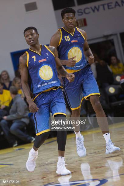 Cleanthony Early and Damian Jones of the Santa Cruz Warriors walk up the court against the Long Island Nets during an NBA GLeague game on November 17...
