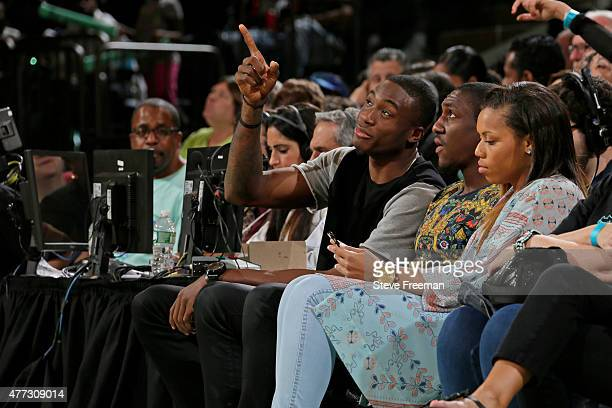 Cleanthony Early and Langston Galloway of the New York Knicks attend the Washington Mystics WNBA game against the New York LIberty on June 14 2015 at...