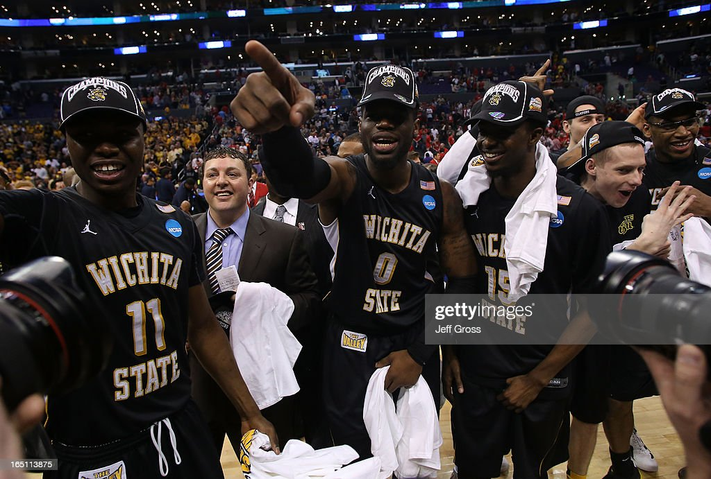 Cleanthony Early #11, Chadrack Lufile #0 and Nick Wiggins #15 of the Wichita State Shockers celebrate after defeating the Ohio State Buckeyes 70-66 during the West Regional Final of the 2013 NCAA Men's Basketball Tournament at Staples Center on March 30, 2013 in Los Angeles, California.