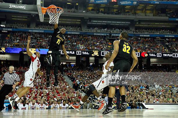 Cleanthony Early of the Wichita State Shockers dunks in the first half against the Wayne Blackshear of the Louisville Cardinals during the 2013 NCAA...