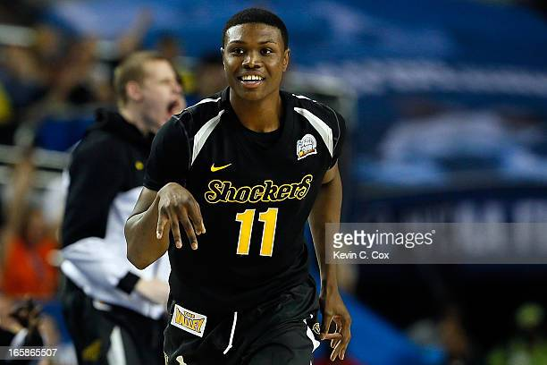 Cleanthony Early of the Wichita State Shockers reacts after he made a 3point basket in the second half against the Louisville Cardinals during the...