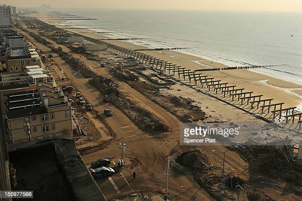 Clean-up continues amongst piles of debris where a large section of the iconic boardwalk was washed away on November 10, 2012 in the heavily damaged...