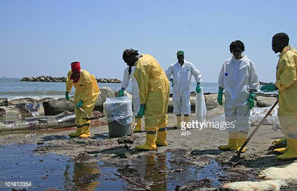 A BP cleanup crew shovels oil from a beach on May 24 2010 at Port Fourchon Louisiana Underfire BP chief executive Tony Hayward admitted at a press...