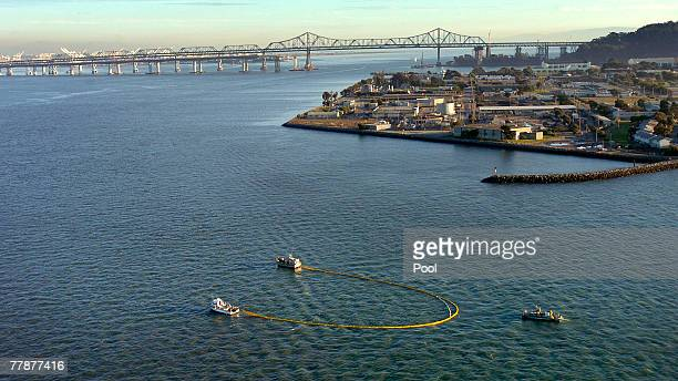 Cleanup crews aboard boats use a boom to contain oil north of Treasure Island November 12 2007 in San Francisco Bay California A container ship...