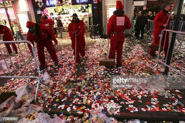 Cleanup crews start to gather some of the three tons of confetti left in Times Square after traditional celebrations on New Years Eve January 1 2007...