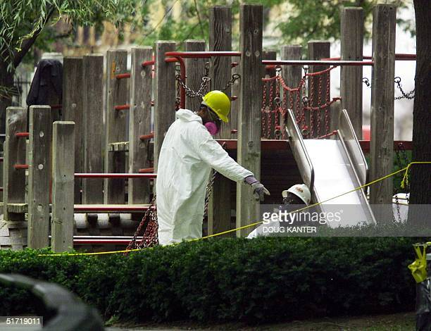 Cleanup crews work in Washington Market Park in lower Manhattan after asbestos was found 30 September 2001 The park is a few blocks from the World...
