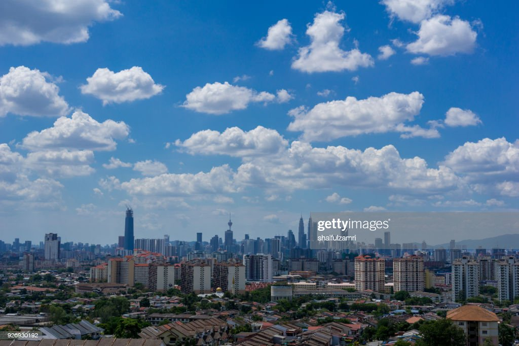 A clear and windy day in Kuala Lumpur,  capital of Malaysia. Its modern skyline is dominated by the 451m tall KLCC, a pair of glass and steel clad skyscrapers. : Stock Photo