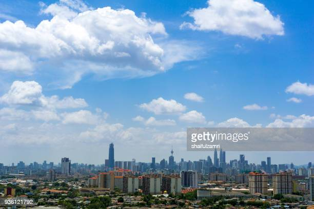 a clear and windy day in kuala lumpur, capital of malaysia. its modern skyline is dominated by the 451m tall klcc, a pair of glass and steel clad skyscrapers. - shaifulzamri stock pictures, royalty-free photos & images