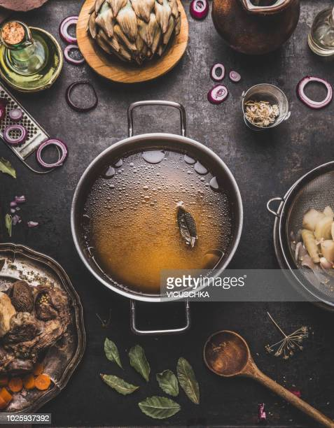 clear beef bone broth or stock in cooking pot - vintage stock stock pictures, royalty-free photos & images