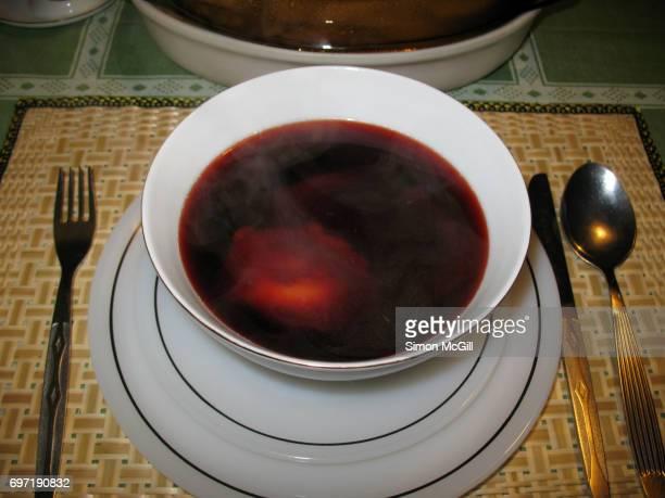 Clear beetroot soup (borscht) with dumplings (pierogi)