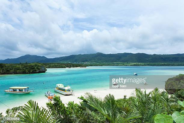clear blue lagoon bay of tropical - 沖縄県 ストックフォトと画像