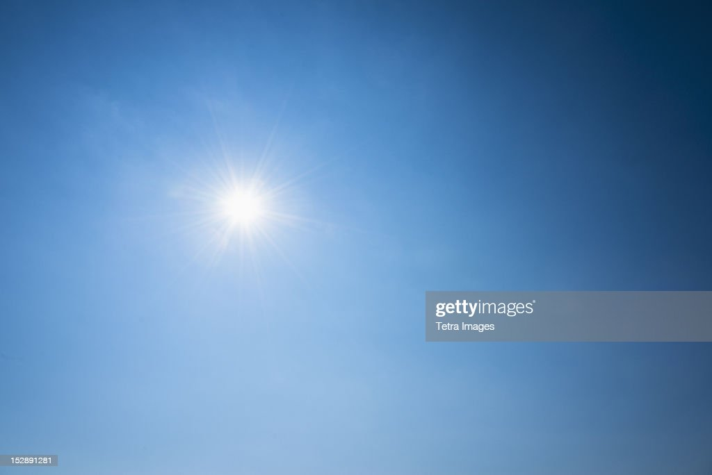Clear blue sky and solar flare : Stock Photo
