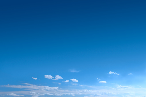 Clear Blue Sky Background With Scattered Clouds 184304316