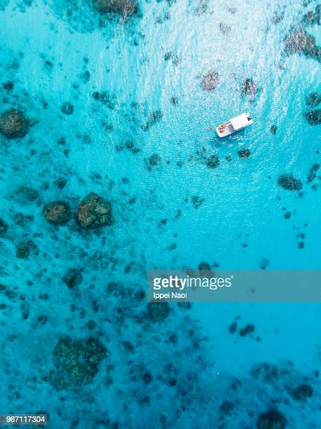 Clear blue tropical sea and boat from above, Kerama Islands, Okinawa, Japan