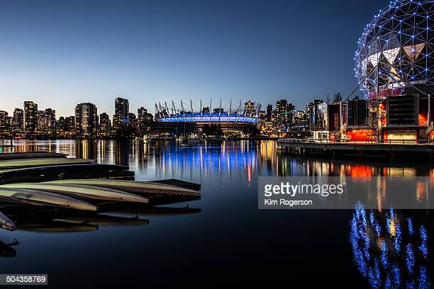 Clear evening in False Creek, Vancouver, BC Place and Science World in blue.