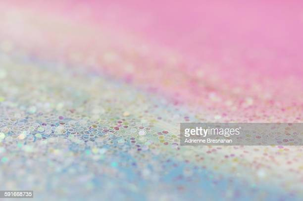 Clear glitter on pastel rainbow background