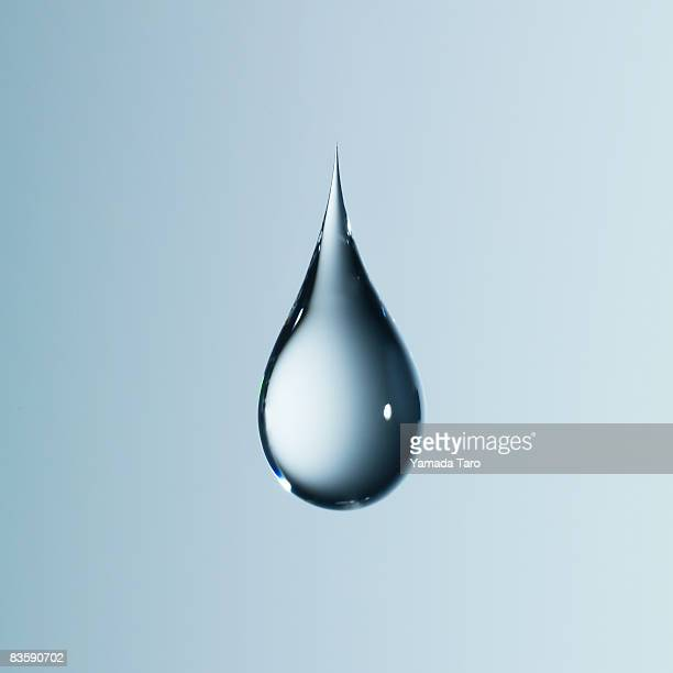 clear light blue drop on light blue back - water stock pictures, royalty-free photos & images
