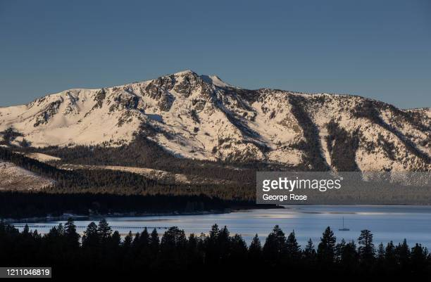 Clear morning sky over the mountains is viewed at sunrise on March 5 in South Lake Tahoe, California. After a series of heavy snowstorms in December,...