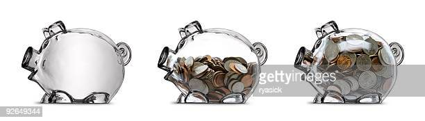 clear piggy bank savings stages empty half filled full isolated - piggy bank stock photos and pictures