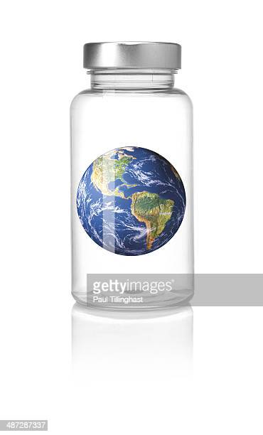 Clear pill bottle and earth