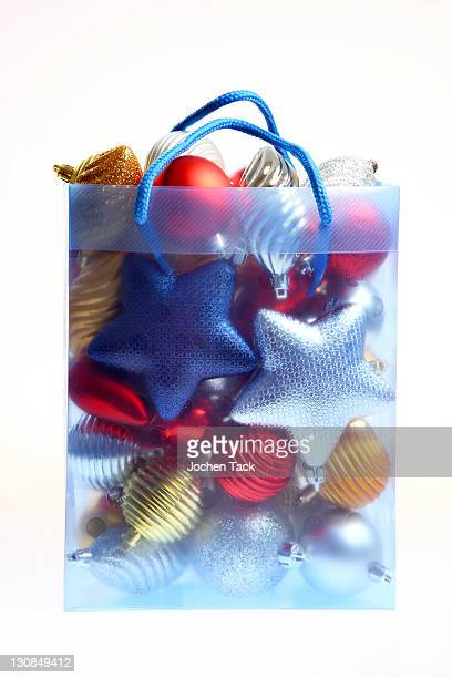 Clear plastic bag filled with Christmas decorations