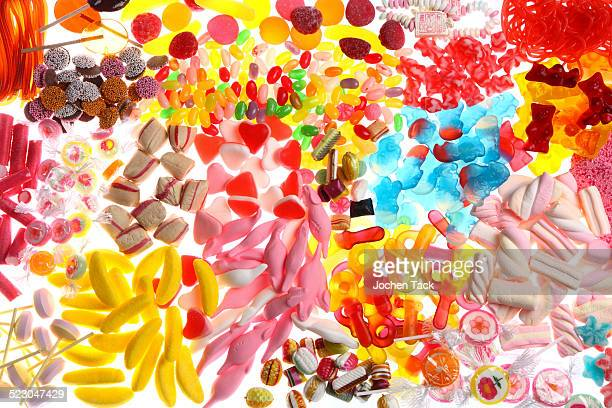 Clear plastic bags with a variety of fruit gums, marshmallows, candies, lollipops, cookies and gummy bears