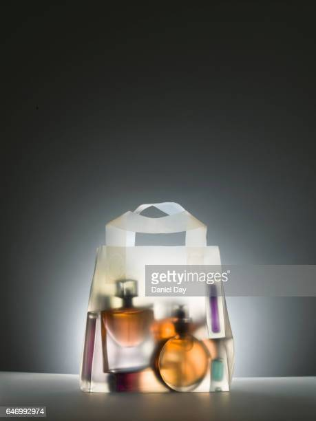 Clear shopping bag with perfume bottles inside
