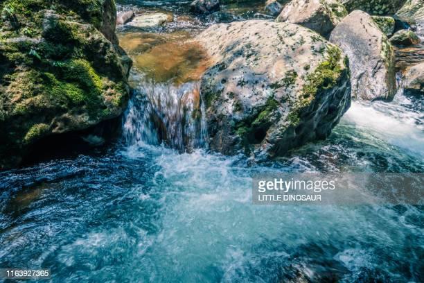 clear stream. long exposure.at akame 48waterfalls - fuente corriente de agua fotografías e imágenes de stock