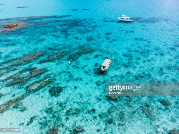Clear tropical water and boats from above, Okinawa, Japan