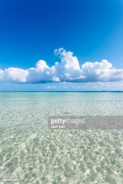 Clear tropical water and cumulus clouds on the horizon, Kumejima
