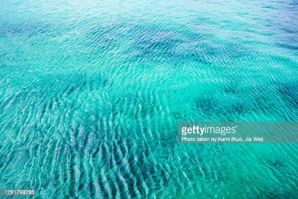 clear turquoise blue sea wave surface. - emerald green stock pictures, royalty-free photos & images