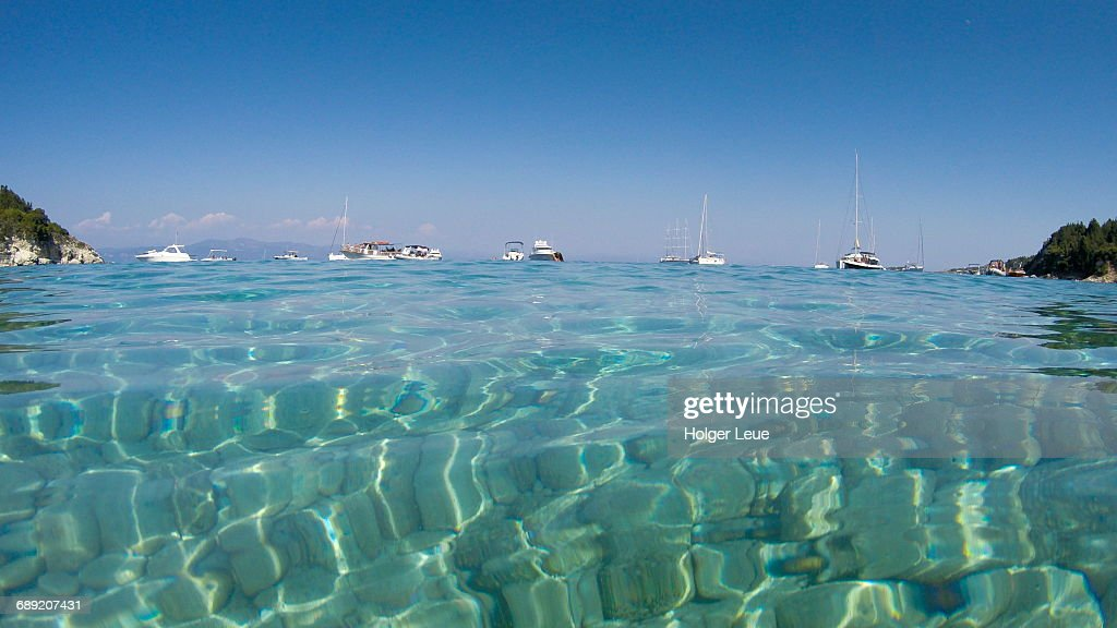 Clear waters in bay with sailboats : Stock Photo