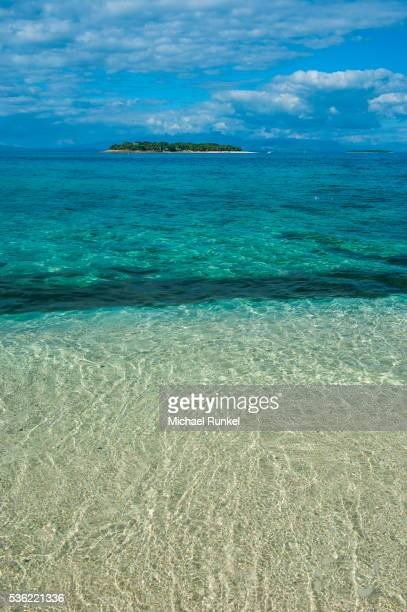 Clear waters on Beachcomber Island with a little islet in the background, Mamanucas Islands, Fiji, South Pacific, Pacific