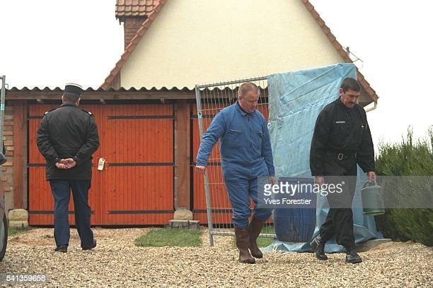 Clearing away various objects found on the scene of the killings committed in April 96 June 97